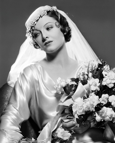 The 1933 bride aspired to be as elegant and demure as a screen siren.