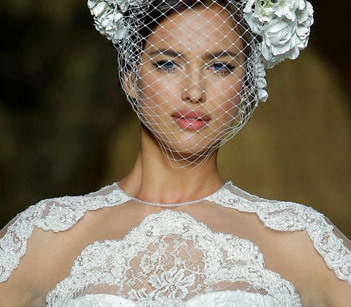 On the runway, wedding makeup and hairstyles can be just as exciting as the dresses themselves.